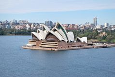 Panoramic landscape view of Sydney Opera House and downtown right after sunrise in Sydney Harbour Royalty Free Stock Photography
