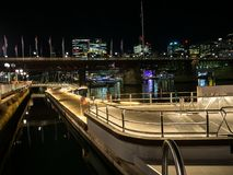 Beautiful Waterfront harbourside walkway at Darling Harbour with cityscape view at the background in night time.rpose spaces. SYDNEY, AUSTRALIA  On June 10 royalty free stock photos
