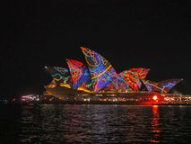 SYDNEY, AUSTRALIA - JUNE 3 2015: psychedelic sydney opera house brightly lit with multicolours and patterns. SYDNEY, AUSTRALIA - JUNE 3 2015: a psychedelic royalty free stock photo