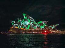 SYDNEY, AUSTRALIA - JUNE 3 2015: sydney opera house brightly lit up with green and gray patterns. During the vivid festival 2015 royalty free stock photo
