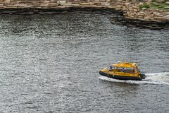 Yellow water taxi on the move, Sydney Australia. Sydney, Australia - March 21, 2017: Closeup of small yellow water taxi on the move at Millers Point. Passengers Royalty Free Stock Photo