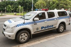 Police car parked on College Street, Sydney Australia. Sydney, Australia - March 23, 2017: Closeup of white and blue police SUV car of canine unit parked on Royalty Free Stock Photo