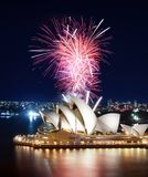 Incredible volley of pink fireworks erupting above the Sydney Opera House stock photos