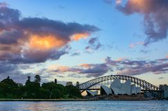 Sydney Harbour Bridge and Opera House under a beautiful sunset. Sydney, Australia - March 7, 2018 - Evening draws to a close with an incredible sunset and light Stock Images
