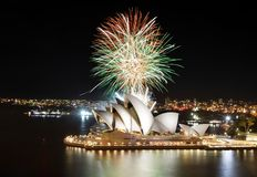 Colorful mix of orange, green, and white fireworks over the Sydney Opera House. Sydney, Australia - March 8, 2018 - A fireworks finale sends up a barrage of royalty free stock photography
