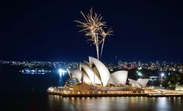 Blast of gold sprinkler-like fireworks at the Sydney Opera House. Sydney, Australia - March 8, 2018 - Gold colored fireworks sprinkle the night sky over the stock photos