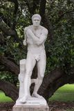 Half of historic duo statue The Boxers, Sydney Australia. Sydney, Australia - March 23, 2017: Half of historic white marble statue duo called The Boxers, by Royalty Free Stock Images