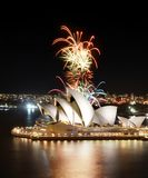 Multiple fireworks explode in an array of colors over the famous Sydney Opera House. Sydney, Australia - March 8, 2018 - The Sydney Opera House hosts an stock photography
