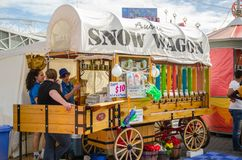 `Snow wagon` Frozen colorful Drink sell on wooden stall cart at Sydney Royal Easter show. stock images