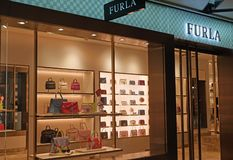 Exterior of Furla store with bags on display. Furla is an Italian luxury fashion company stock photos