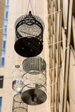 SYDNEY, AUSTRALIA - NOVEMBER 2, 2014:. Forgotten Songs is an artistic installation of empty birdcages hanging in the sky on the angle of Place lane way Stock Images