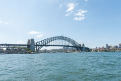 SYDNEY, AUSTRALIA - NOVEMBER 12, 2014: Harbour Bridge in Sydney with River and Ferry. Royalty Free Stock Images