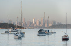 SYDNEY, AUSTRALIA - NOVEMBER 13, 2014: Morning Cityscape in Sydney with Westfield Tower, Yacht and Ocean Water. Stock Photo