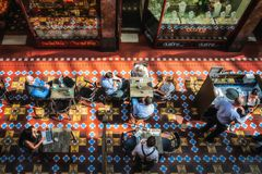 A Cafe at the Strand Arcade in Sydney. SYDNEY, AUSTRALIA - November 2, 2017: people enjoying a cofee at the Strand Arcade, a multi-level Victorian-style gallery Royalty Free Stock Image