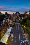 SYDNEY, AUSTRALIA - November 6, 2016: Sunset at The rocks historic district in the city view from top on george street illuminate. D houses and Sydney Harbour royalty free stock images