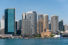 SYDNEY, AUSTRALIA - NOVEMBER 05, 2014: Sydney Business Architecture. Harbour with Ferry. The Rocks. Sydney Business Architecture. Harbour with Ferry. The Rocks stock image