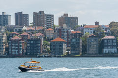 SYDNEY, AUSTRALIA - NOVEMBER 05, 2014: Sydney Business Architecture. Harbour with Yellow Water Taxi. Royalty Free Stock Images