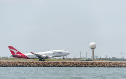 SYDNEY, AUSTRALIA - NOVEMBER 11, 2014: Sydney International Airport With Take Off Airplane. Aircraft VH-OJS, Boeing 747-438, Qanta Stock Photo