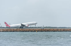 SYDNEY, AUSTRALIA - NOVEMBER 11, 2014: Sydney International Airport With Take Off Airplane. Aircraft VH-VPF, Boeing 777-3ZG, Virgi Royalty Free Stock Photography