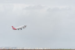 SYDNEY, AUSTRALIA - NOVEMBER 11, 2014: Sydney International Airport With Take Off Airplane. Qantas, Airbus A330-303, VH-QPC Royalty Free Stock Image