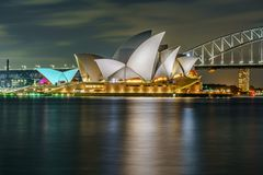 Sydney, australia - november 8, 2018: the sydney opera house at night. Sydney, australia - november 8, 2018: the sydney opera house and the sydney harbour bridge stock image