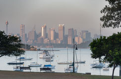 SYDNEY, AUSTRALIA - NOVEMBER 13, 2014: Watsons Bay Morning in Sydney, Australia. Water with Yacht and Cityscape in background Stock Images