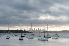 SYDNEY, AUSTRALIA - NOVEMBER 13, 2014: Watsons Bay in Sydney, Australia. Water with Yacht and Cityscape in background Stock Image