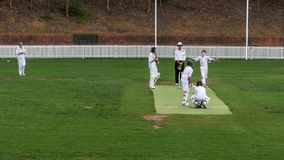 SYDNEY, AUSTRALIA -November 30, 2014: wide shot of two teams competing in a game of cricket. SYDNEY, AUSTRALIA -November 30, 2014: wide shot of two boys teams royalty free stock images