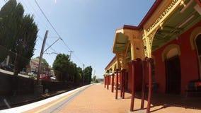 Beautiful orange old design building of Arncliffe railway station on sunshine day. Sydney, Australia. – on October 26, 2018. - Beautiful orange old stock video footage