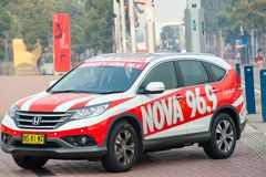 Honda car with signage for a Sydney radio station, Nova 96.9 parked at a fun running event royalty free stock photo