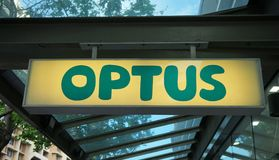 Optus signage above the entrance to their retail store on Oxford Street. Sydney, Australia - October 17, 2017: Optus signage above the entrance to their retail stock image