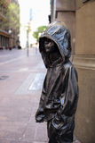 SYDNEY, AUSTRALIA - Sept 12, 2015 - A bronze sculpture of a boy with a hooded jacket at Barrack Street. Sculpture by Caroline Roth Stock Photography