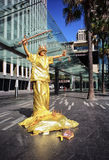SYDNEY, AUSTRALIA - Sept 12, 2015 - Street performer mimicking statue-like post at tourist attraction area, Circular Quay Stock Image