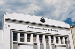 Historical old buildings of Commonwealth Bank in Newtown with Coat of arms of Australia in classic version. SYDNEY, AUSTRALIA. - On September 23, 2017 Royalty Free Stock Photo