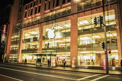 The main Apple store in Sydney at night time. stock images
