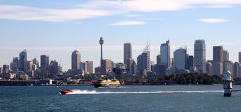 Sydney, Australia skyline. From the harbour with a speedboat passing Royalty Free Stock Photos