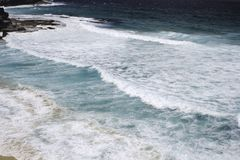 Sydney beach. Sea waves and rocks. Top view royalty free stock images