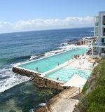 Sydney Bondi Icebergs Pool. Sydney, Australia, Bondi Icebergs pool with waves crashing on the rocks Stock Photo