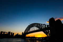 Sydney bridge sunset. Sydney harbour bridge and city from the north shore at Kirribilli during sunset Royalty Free Stock Photo