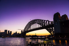 Sydney bridge sunset. Sydney harbour bridge and city from the north shore at Kirribilli during sunset Stock Photos