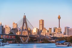 Sydney business district cityscape with Anzac bridge and harbour view. Urban landscape at sunset stock images
