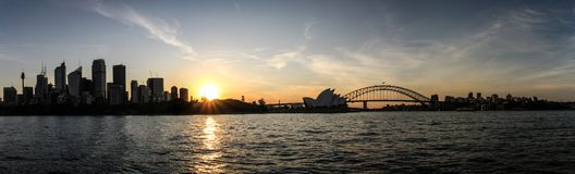 Panoramic view of Sydney city, opera house and harbour bridge sunset from Mrs Macquarie`Chair, Sydney, New South Wales, Australia. Sydney, capital of New South royalty free stock images
