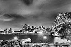 Sydney CBD Millsons Foreland BW. Australia Sydney city landmarks high-rise skyscrapers and sydney harbour bridge after sunset illuminated black-white Royalty Free Stock Photos