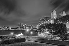 Sydney CBD Milsons Grass Sunset BW. Australia Sydney city CBD and harbour bridge landmarks view from Milsons Point at sunset in black and white Royalty Free Stock Photo
