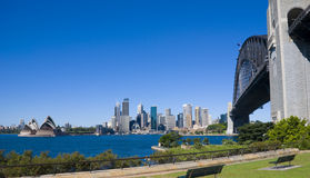 Sydney City Opera Bridge. City of Sydney with Opera House and Harbour Bridge on a perfect clear blue sky day Stock Images