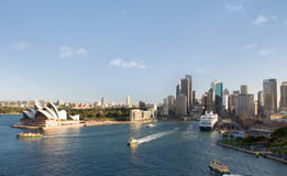 Sydney City Skyline. Sydney centre skyline scenery with famous Opera House, Royal Botanic Gardens, Circular Quay, harbour with huge transoceanic ship and ferries