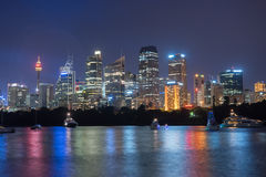 Sydney City Skyline at Night. Beautiful scene of colorful Sydney city skyline at night with reflection Stock Image
