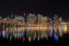 Sydney city skyline at night near Pyrmont Bridge, Cockle Bay Wha Royalty Free Stock Images
