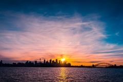 Sydney city skyline silhouette. At sunset, NSW, Australia Stock Image