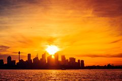 Sydney city skyline silhouette. At sunset, NSW, Australia Royalty Free Stock Photo